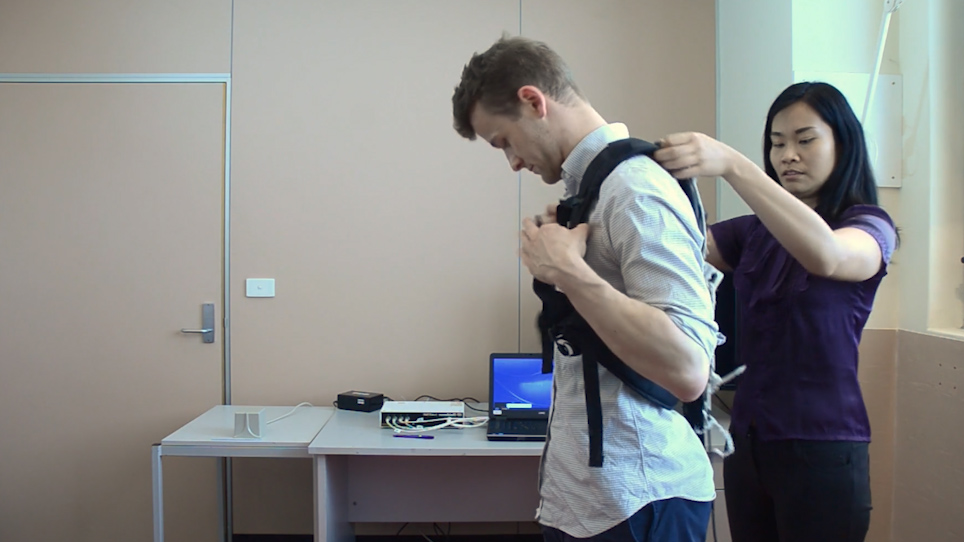 An Instrumented Pull Test to Characterize Postural Responses