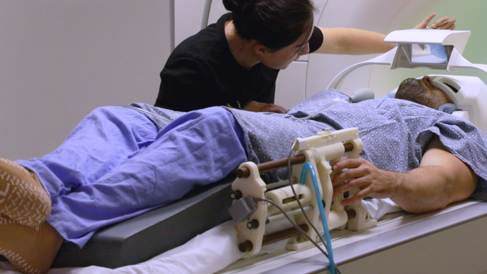Functional MRI in Conjunction with a Novel MRI-compatible Hand-induced Robotic Device to Evaluate Rehabilitation of Individuals Recovering from Hand Grip Deficits